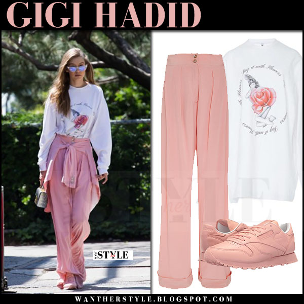 Gigi Hadid in white print sweatshirt and pink trousers adam selman and pink sneakers what she wore june 11 2017
