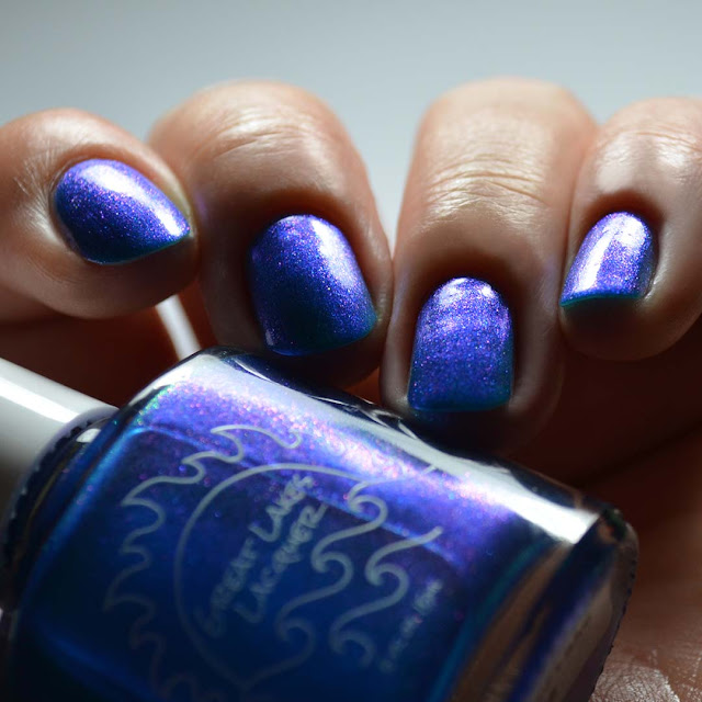 inky blue nail polish with aurora shimmer