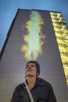 An exhibit that turns air pollution into public art opened Friday on the wall of UNC Charlotte Center City. The installation makes visible the fine particles that can be deadly. (Credit:  Mark Hames) Click to Enlarge.