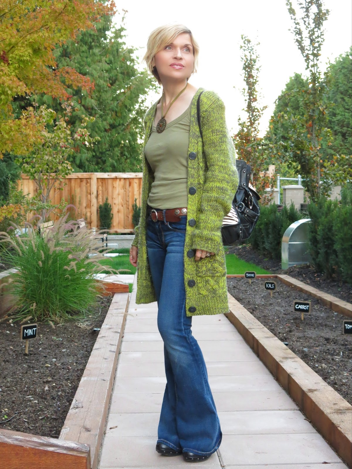 styling flare jeans with a tank top and chunky grandpa cardigan