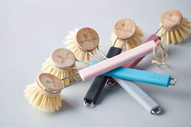 natural plant based bristle brushes for cleaning the kitchen with handles that have colourful accents
