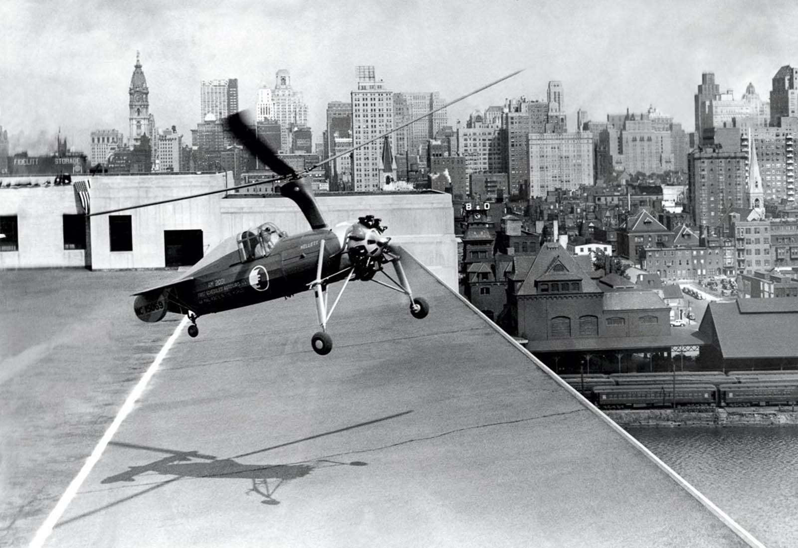 An autogyro takes off from a rooftop in Philadelphia. 1930.
