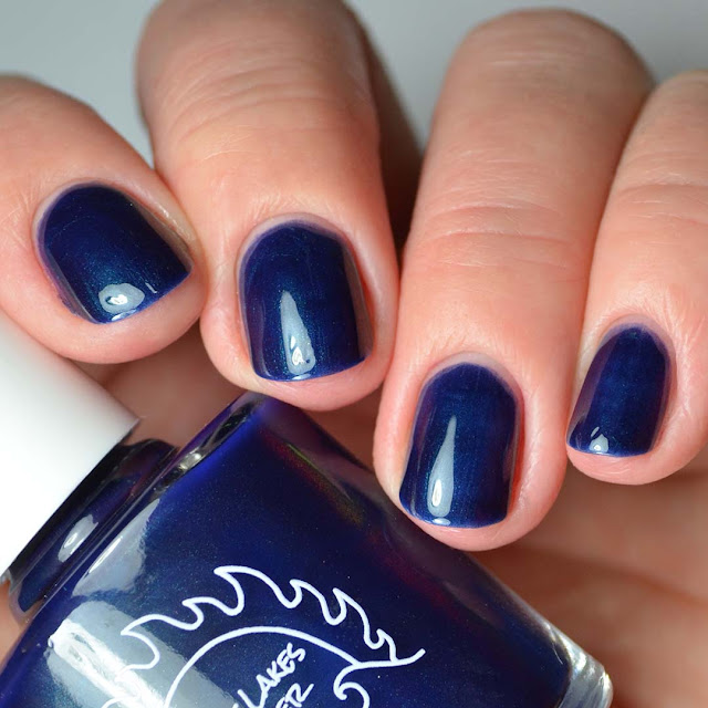 blue color shifting nail polish four finger swatch