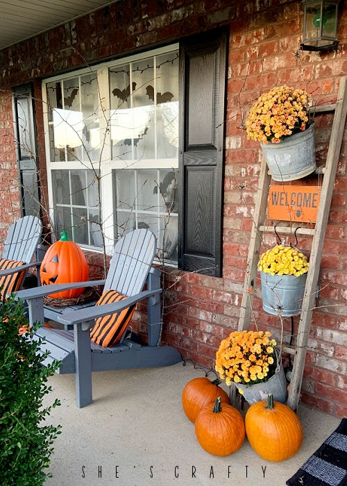 Halloween Porch - pumpkins, mums, vintage ladder, Adirondack chair