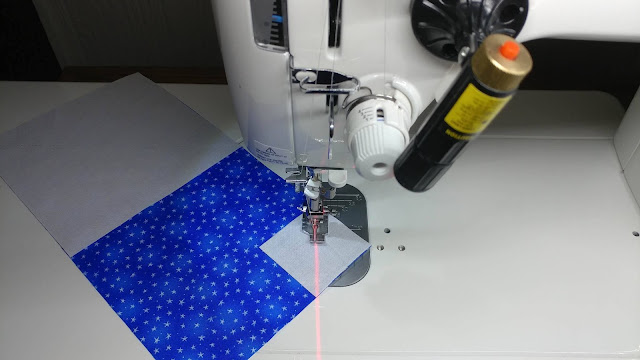 Using my sewing machine laser for my red, white, and blue heart quilt for USS Fitzgerald
