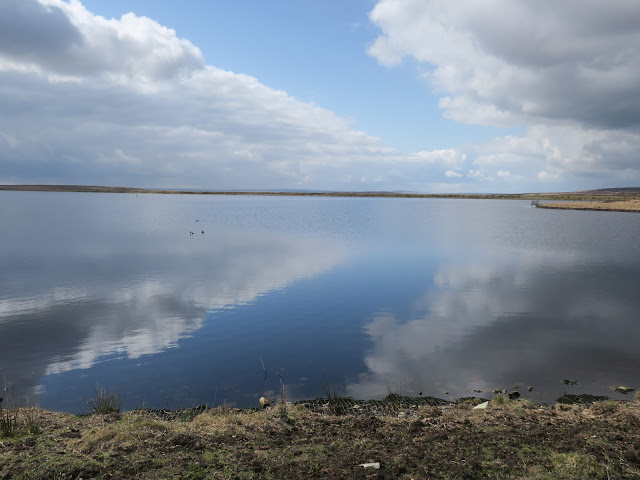 WARLEY RESERVOIR, CALDERDALE, WEST YORKWHIRE, ENGLAND, MAY 1ST 2021 with clouds reflected in water.