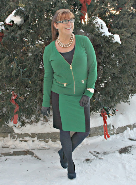 Michael Kors green skirt and cardigan with navy accents and gold accessories