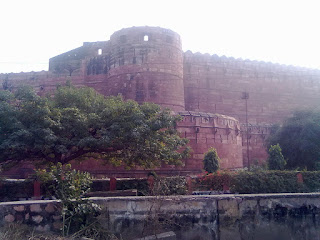 agra fort as seen from train crossing over railway nearby it