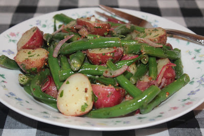 Finished bowl of green bean and red potato salad.