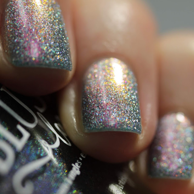 Blue holographic nail polish with pink shimmer