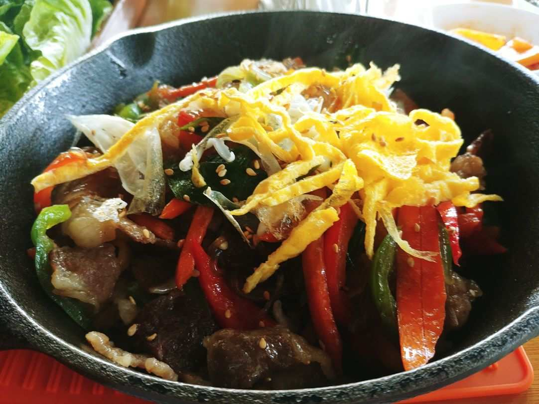 japchae of Korean noodles with meat and vegetables at nice two Meat u