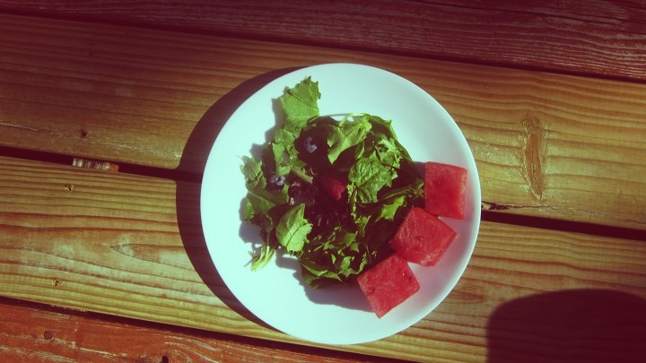 Side Salad with Fresh Watermelon Chunks for Summer Salad on Wooden Deck