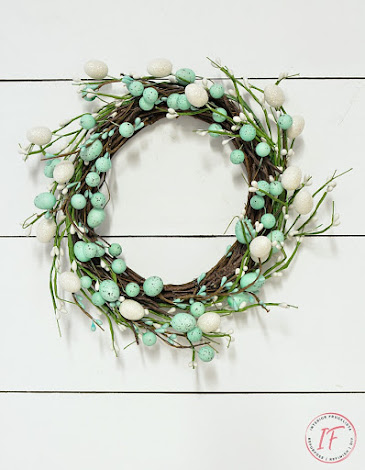 This super easy DIY Easter OR Spring door wreath is an EGGcellent budget-friendly five minute craft using just three items from the dollar store.