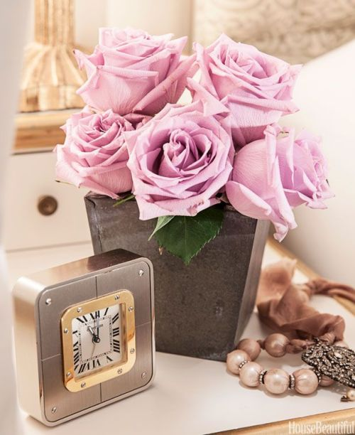 pretty and romantic decoration details gold clock pink roses