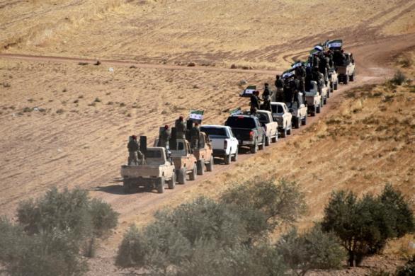Reuters: Σύροι αντάρτες υπογράφουν συμβάσεις ως «σωματοφύλακες» στη Λιβύη