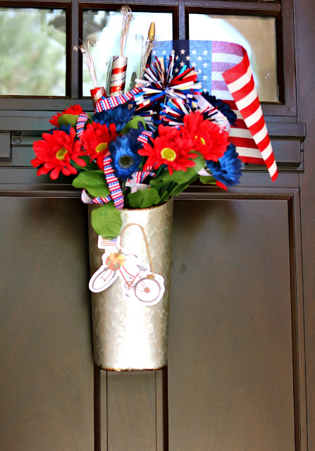 Easy Farmhouse Style Red, White and Blue Door Decor Using a Galvanized Container