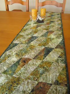 https://www.patchworkmountain.com/collections/table-runners/products/fall-batik-table-runner-with-a-diagonal-style