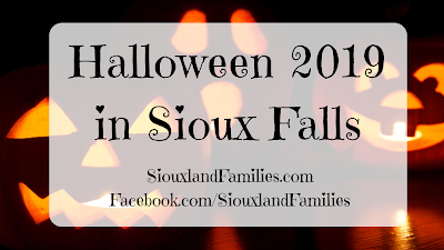 "a trio of candlelit orange jack-o-lanterns grin against a black background. in the foreground, the words ""Sioux Falls Halloween 2019"""