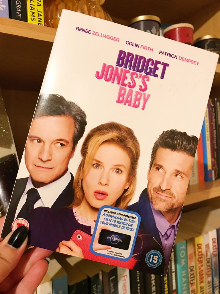 Bridget Jones's Baby DVD held up in front of bookshelf