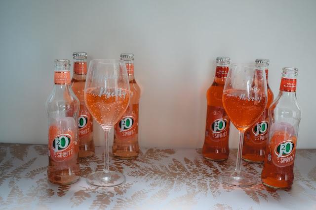J20 Spritz bottles stood on table