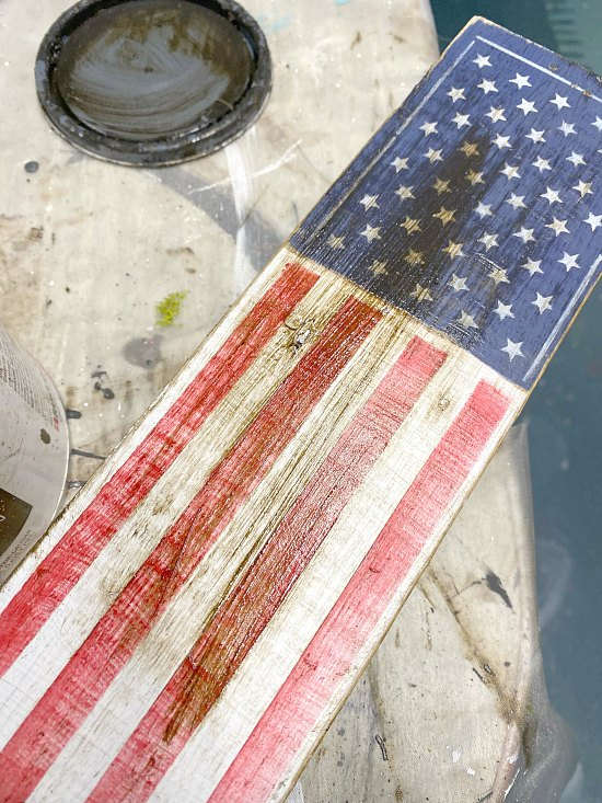 staining the American flag on a wooden stake