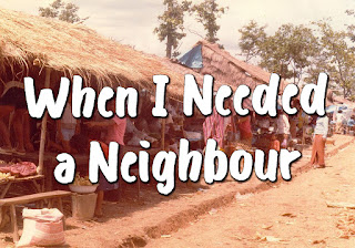 Song title superimposed over a picture of a poor village with houses featuring thatched roofs and many people - When I needed a neighbour were you there, were you there? When I needed a neighbour were you there? And the creed and the colour And the name won't matter Were you there? 2.  I was hungry and thirsty, Were you there, were you there? 3.  I was cold, I was naked, Were you there, were you there  4.  When I needed a shelter Were you there, were you there?  5.  When I needed a healer, Were you there, were you there?  6.  When they put me in prison Were you there, were you there? 7.  Wherever you travel I'll be there, I'll be there. Wherever you travel, I'll be there. And the creed and the colour And the name won't matter I'll be there.