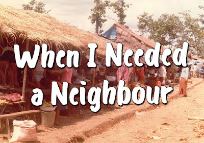 Song title superimposed over a picture of a poor village with houses featuring thatched roofs and many people