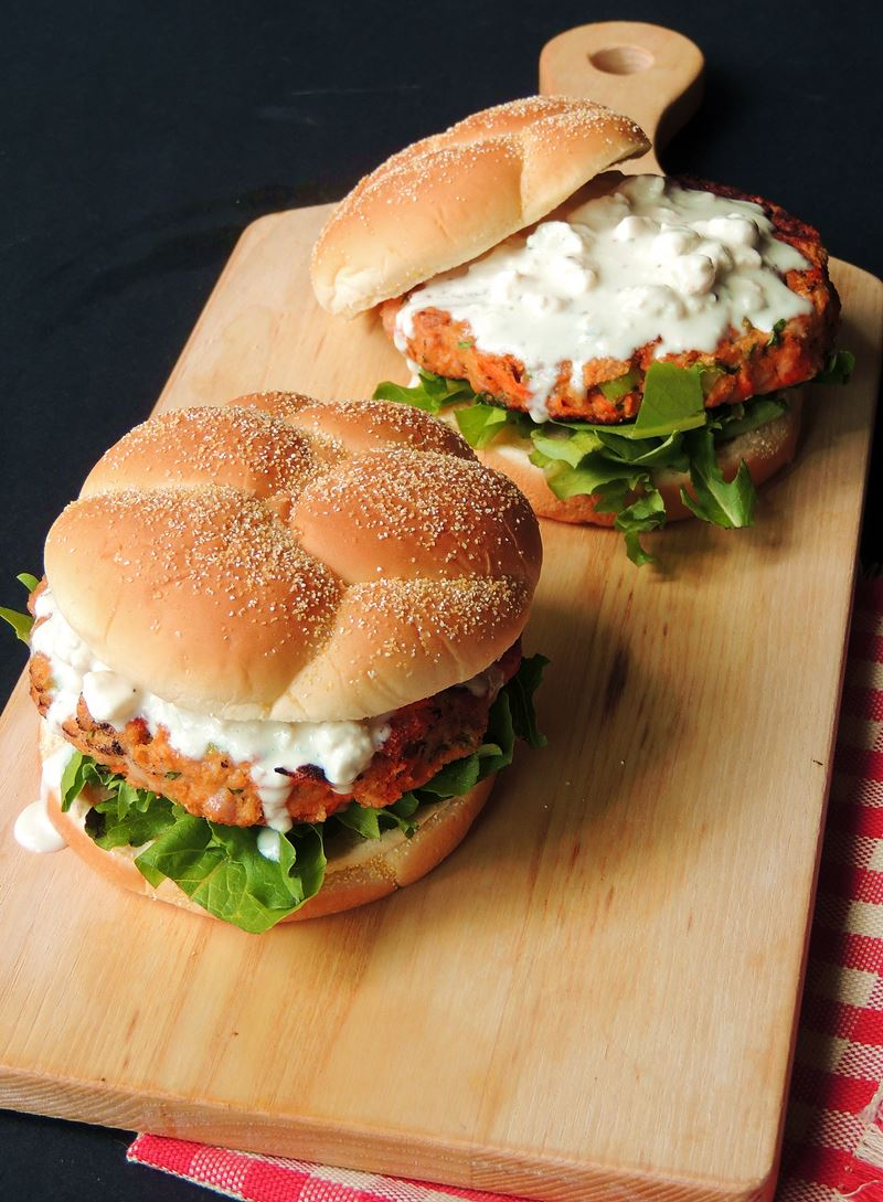 Buffalo Chicken Burgers - Buffalo chicken wings and burgers collide in this mouth-watering Buffalo Chicken Burger with Creamy Blue Cheese Sauce recipe, with the bonus of no messy fingers! #BBQ #grilling #grilled #burger #Burgers #chicken #buffalo #keto #lowcarb #easy #recipe | bobbiskozykitchen.com