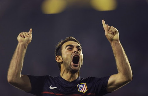 Atlético Madrid sriker Adrián celebrates after scoring against Valencia in the Europa League