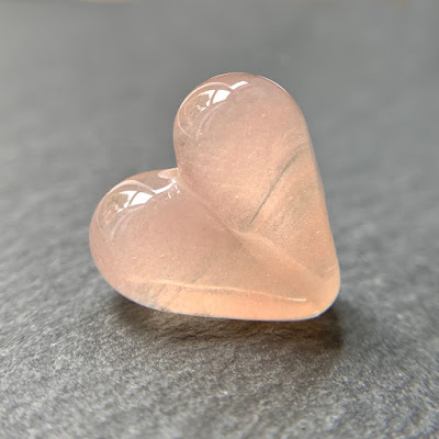 Handmade lampwork glass heart bead by Laura Sparling made with CiM Rosaline Pink