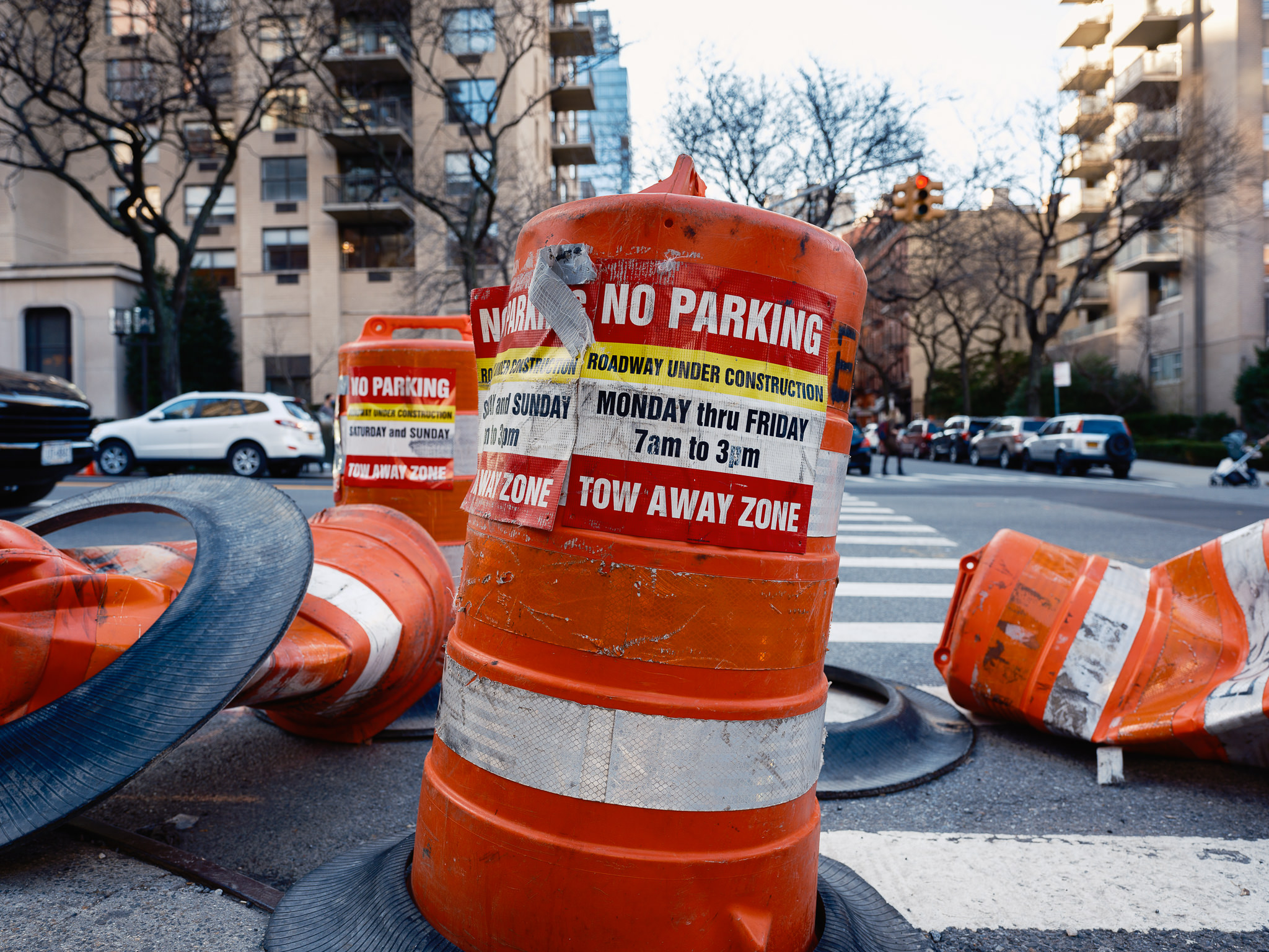 a photo of mangled orange construction barrels in new york city