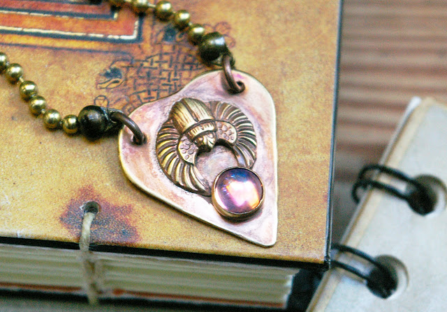 https://www.etsy.com/ca/listing/621955668/brass-scarab-planchette-aura-orb-glass
