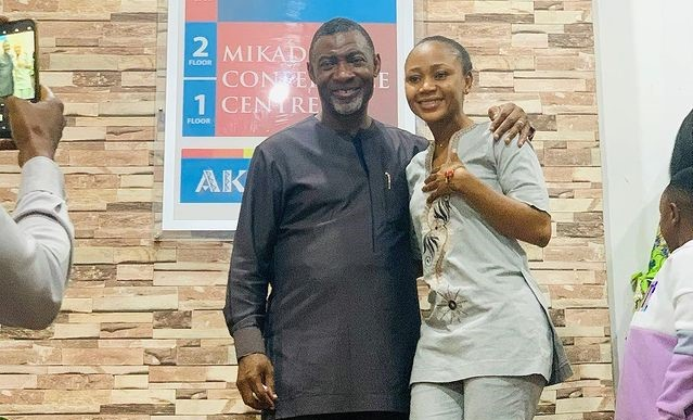 Akuapem Poloo runs to Dr. Lawrence Tetteh for prayers