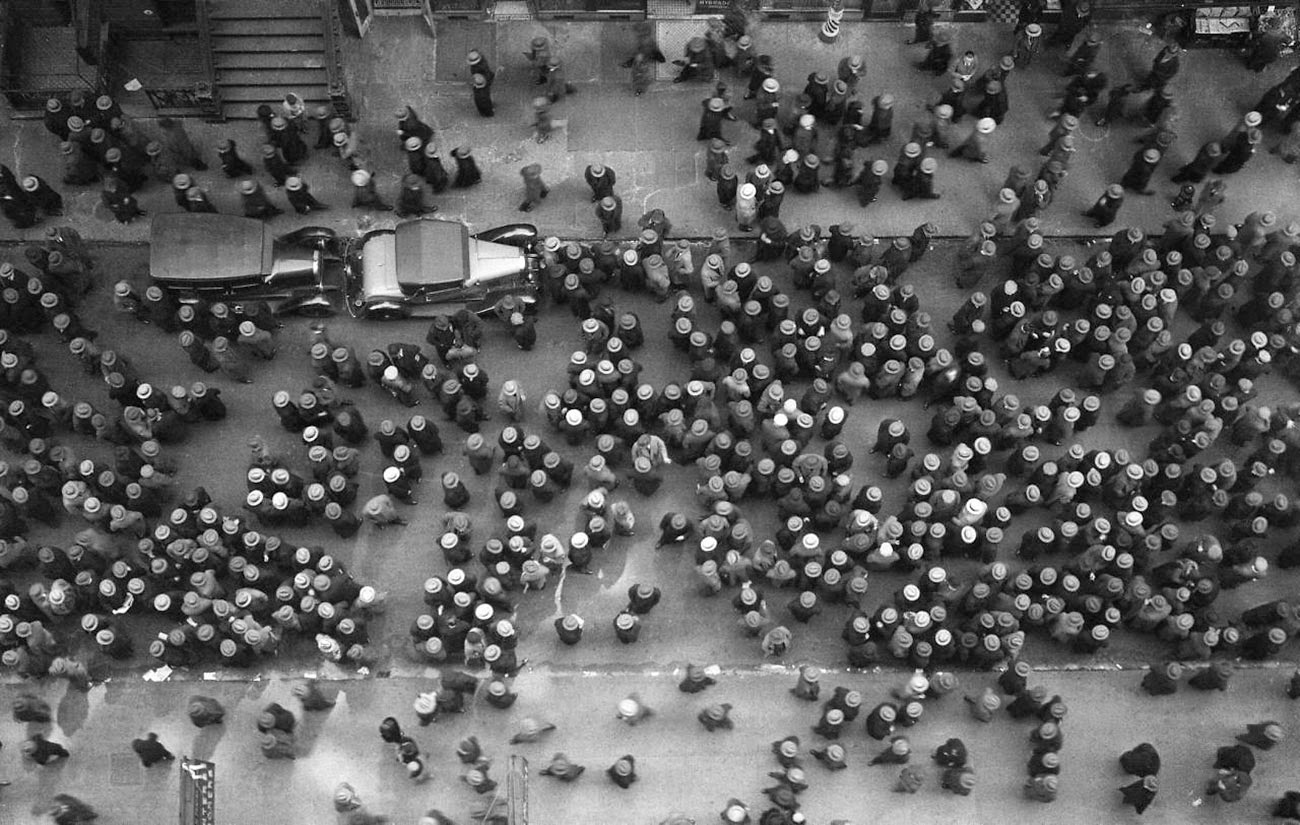A picture of a crowd in New York and there is not one unhatted head, 1930