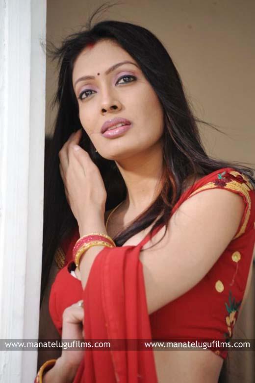 Surabhi Hot Stills In Red Saree
