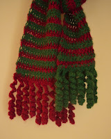 Close-up of curlicue fringe with the green in the front and the red behind.