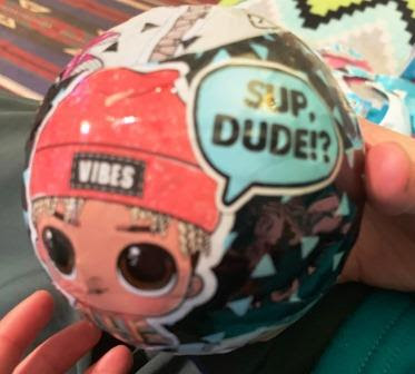 close-up of L.O.L. Surprise Boy ball being unwrapped