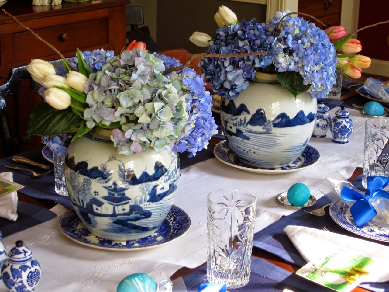 flowers in blue and white cache pots