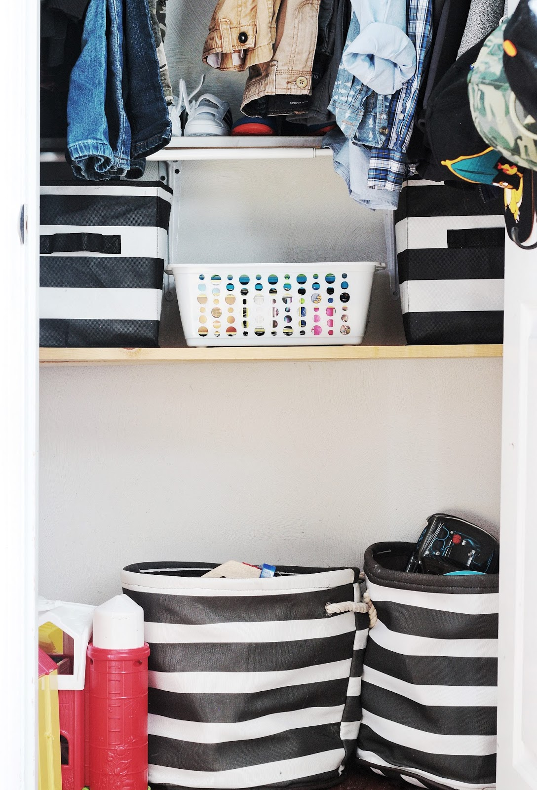 small Organized kids' closet, shelves with storage bins for toys