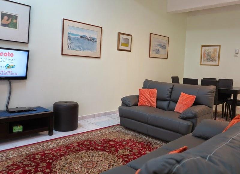 "Photo 1: Living room full leather 3+2 sofa, 32"" TV, fan"
