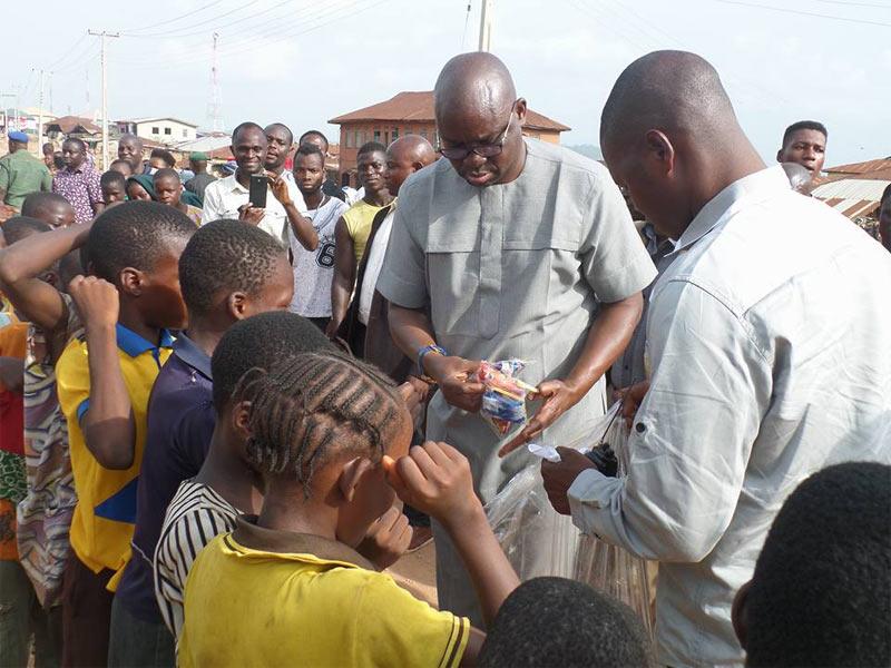 Governor Fayose shares cheese balls to Ekiti children