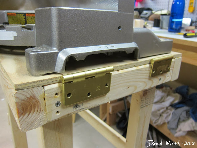folding miter saw arms, hinged, hinges, colapse, storage