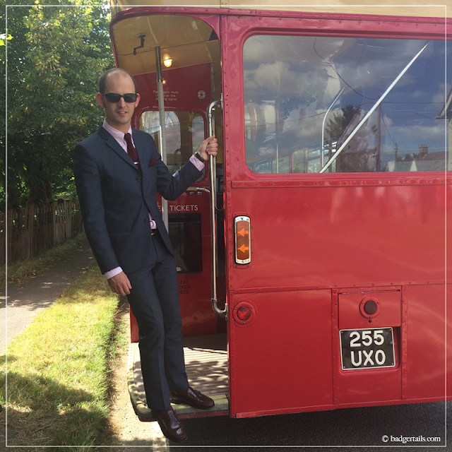 Man-in-Suit-on-Back-of-London-Bus