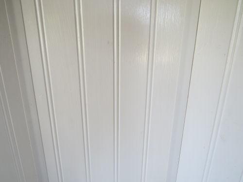 white paneling inside a fiberglass trailer