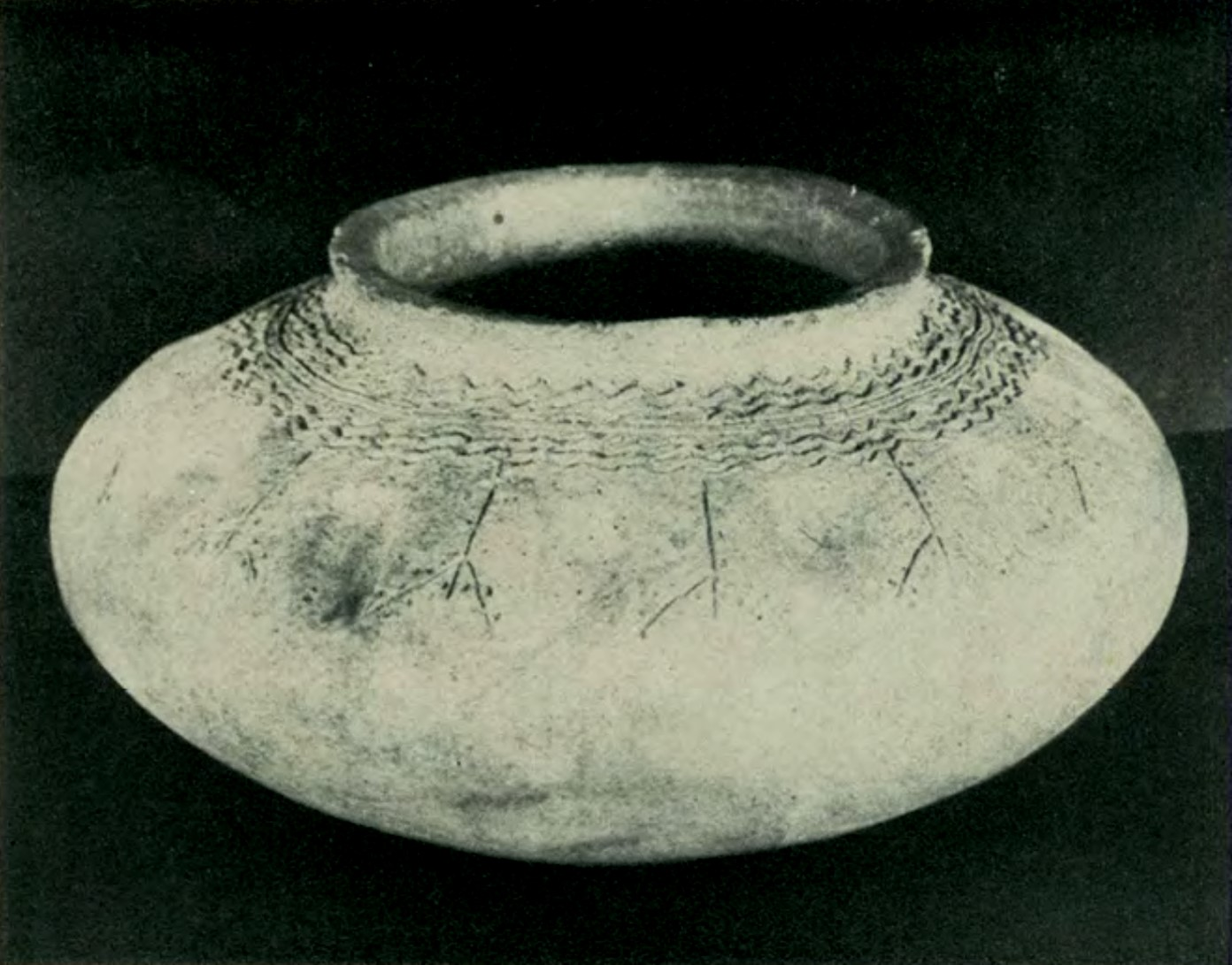 Pot with comb-incised wavy designs recovered from Calatagan