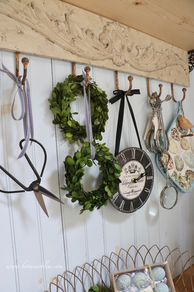 French Country is in the details with a hook shelf decorated with a scroll design