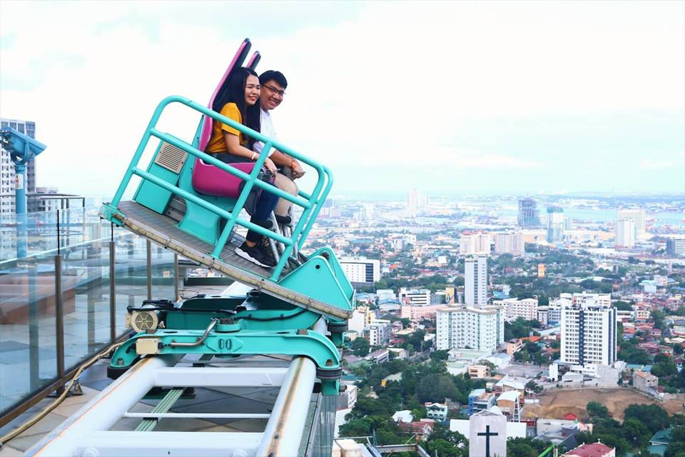 couple riding edge coaster