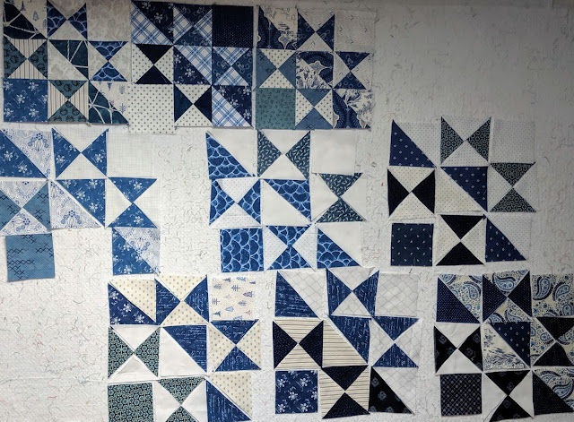 Blue and white blocks laid out on the design wall