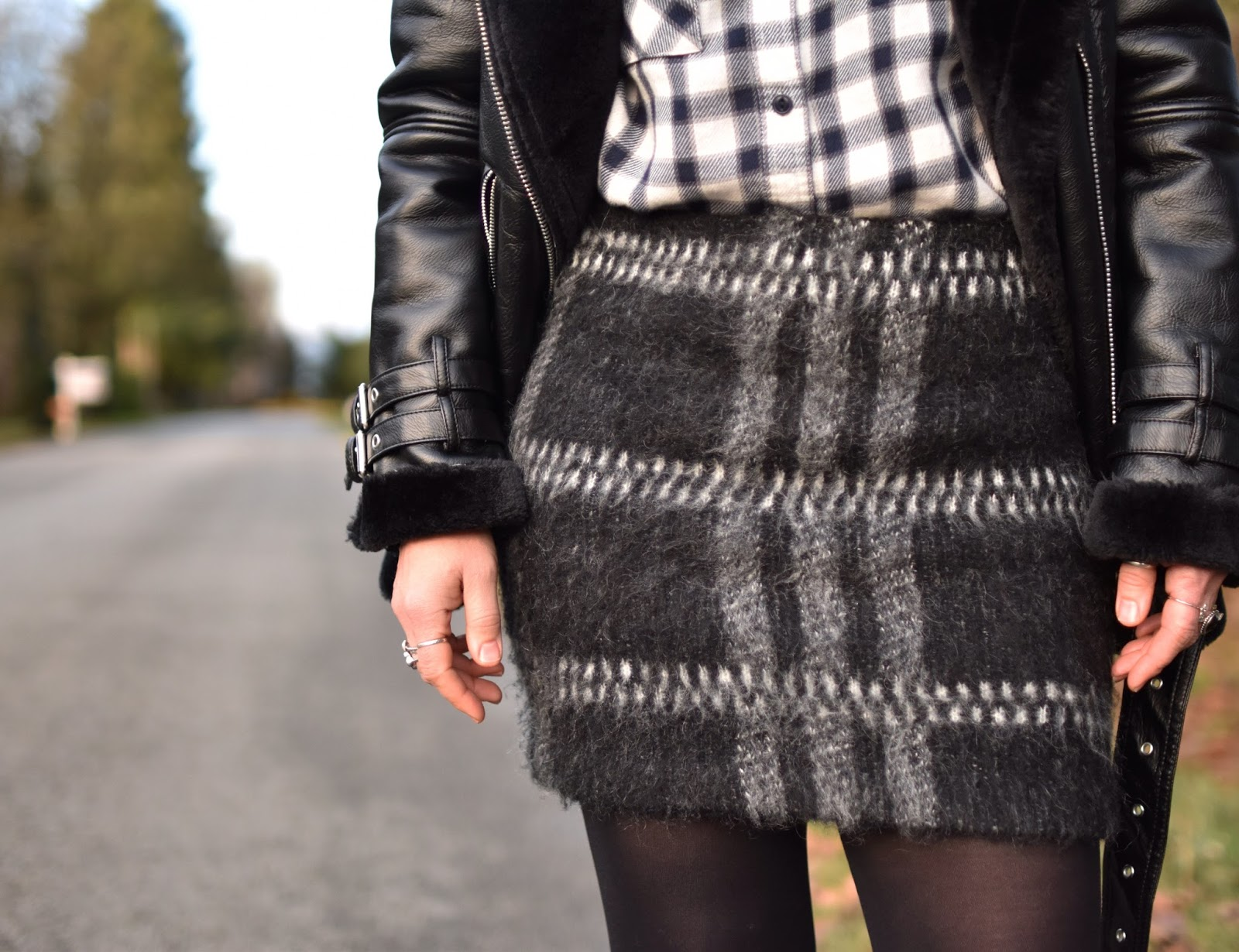 Monika Faulkner outfit inspiration - mohair miniskirt, plaid flannel shirt, opaque tights, moto-inspired coat