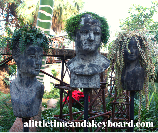 Sculptures with funky plant hairdos at Nicholas Conservatory in Rockford, Illinois